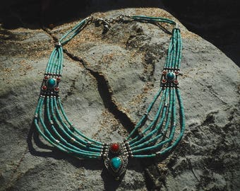 Silver necklace with turquoise and red coral
