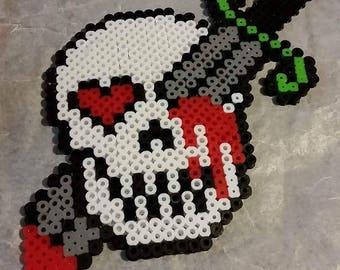 Skull and sword magnet