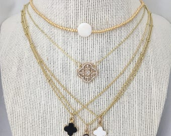 Clover necklaces and white dot choker!
