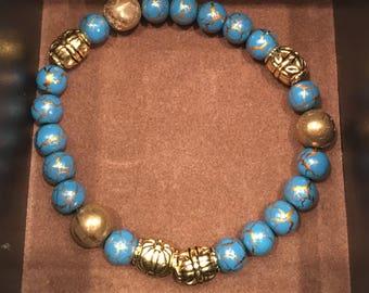 Light Blue and Gold bead bracelet