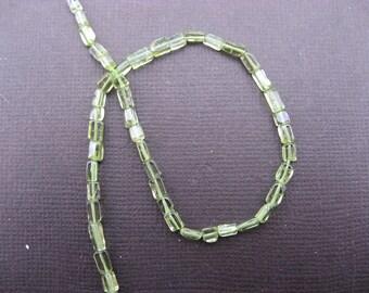 Peridot: 5 3 mm to 6 mm flat rectangle beads