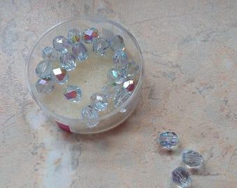 Faceted 6 mm light blue iridescent glass beads