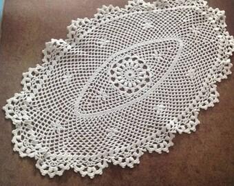 Small oval vintage crochet lace doily