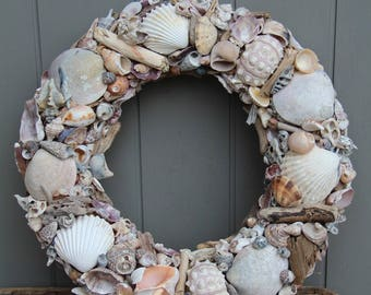 Wreath or table centerpiece with shells mixed in natural shades