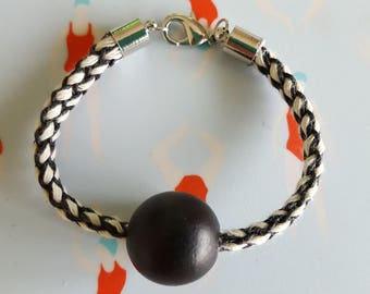 Central ball and braided cord bracelet