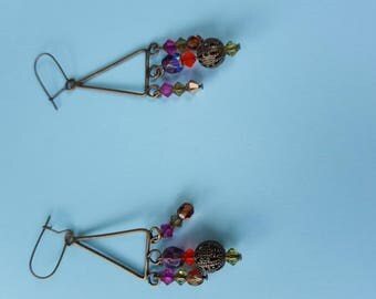 Earrings on bronze and Swarovski pearls