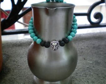 Turquoise and black volcano rock style beads and silver lion head Bangle