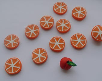 set of 12 pieces of polymer clay shaped Orange