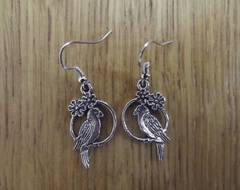 Earrings with silver colored metal birds.