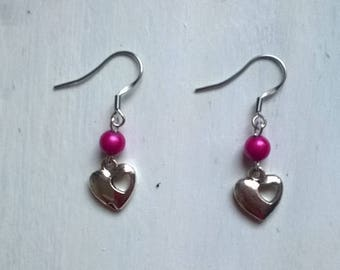 a pair of earrings with silver plated findings