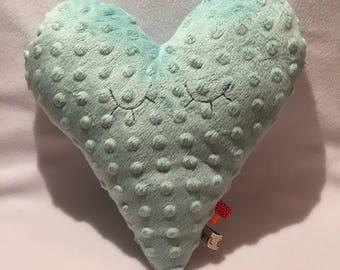 Soft cushion of pale green heart for baby, child or room decoration