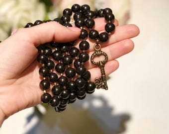 """Shungite long necklace with a brass """"Key for your heart"""""""