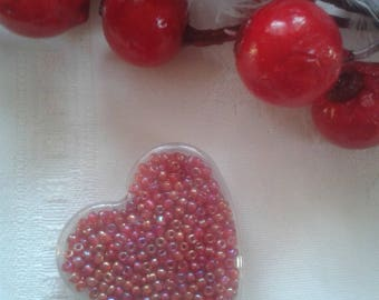 Pearl Orange rock in their box transparent heart