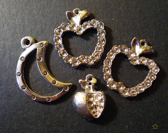 4 metal pendants silver moons and apples