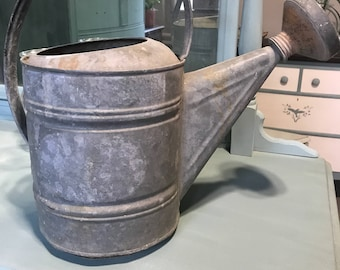 Vintage watering can with spout
