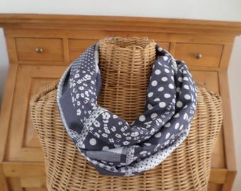 White and charcoal grey snood made with a patchwork style fabric