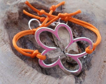 Orange cord and Silver Flower bracelet.