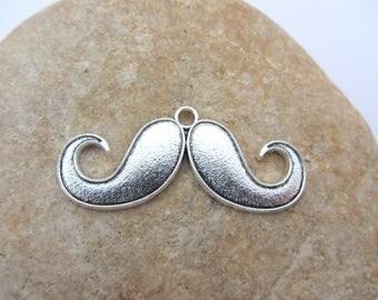 A charm, pendant, large moustache