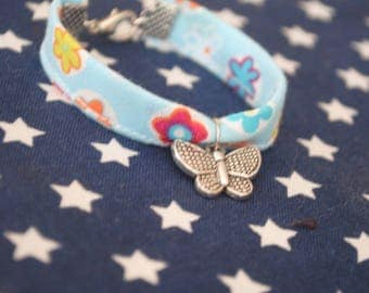 Fabric bracelet with butterfly charm