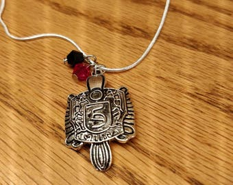 The Vampire Diaries inspired Stefan Salvatore charm necklace with 20in sterling silver chain.