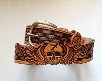 Belt leather tooled with skull in cutting carved