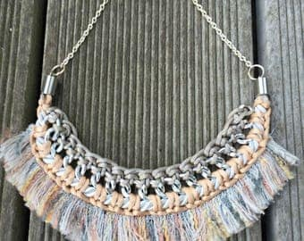 Necklace braided around a silver chain with fringe
