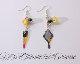 Mirror and lip stick, yellow and black earrings