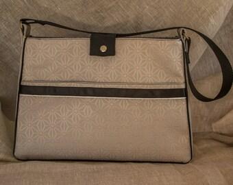 Stylish handbag fabric coated