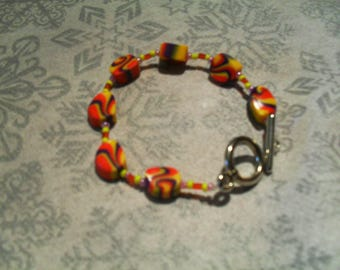 trendy bracelet, original, colorful (purple, yellow and red)