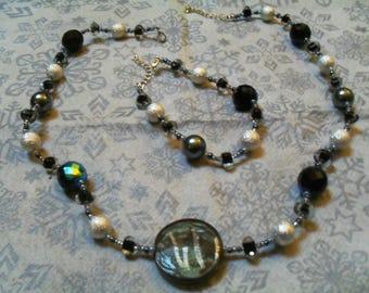 set (necklace and bracelet) fine, classy, (black and silver)