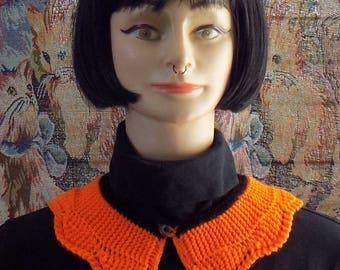 "Neon orange (UV), ""Peter Pan"" collar and black."