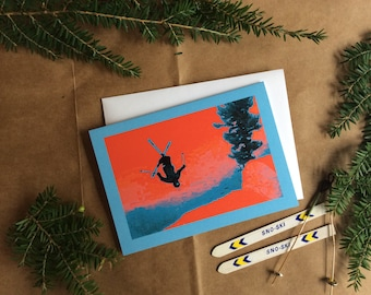 """A Blank Greeting Card for Freestyle Skiers! """"Back X"""" in red and blue."""