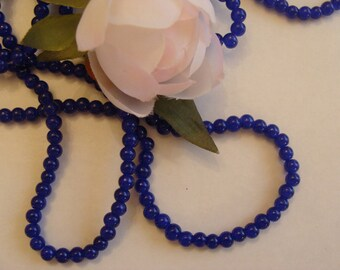 Set of 10 beads in sapphire blue glass
