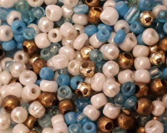 10 grams of beads in different sizes different colors