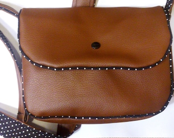small handbag (23cm x18cm height 8cm depth x width), inside black with white dots
