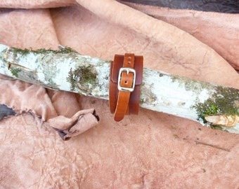 "Tan leather ""medieval"" type power bracelet"
