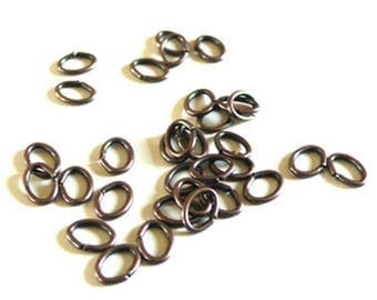 copper colored rings 5mm ovals - 100