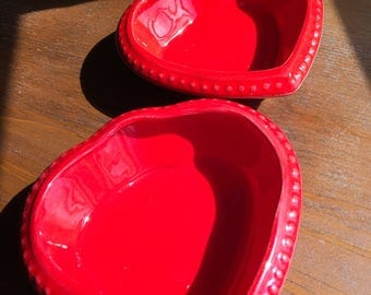 Pair of glossy red heart dishes