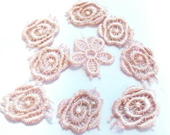 9 pretty flowers in pale pink lace