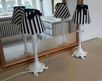 Pair of lamps in bronze patinated white shades striped black and white