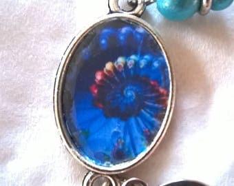 Silver cabochon bracelet spiral turns blue on dark blue, absolutely stunning image!