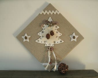 picture in natural linen with tree, pinecones and stars