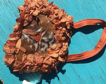 Leather, ribbon and cowhide purse.