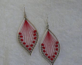 Single earring with woven and red beads