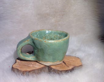 Handmade Ceramic mug. Turquoise Speckled Glaze. Hand crafted on a potters wheel.
