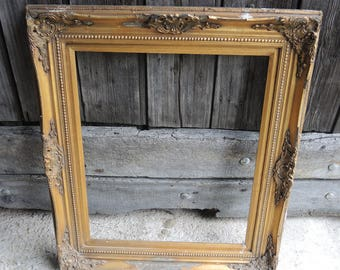 Old frame in stucco gilt wood