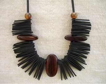 Ethnic necklace in inner tube recycled and exotic wood pallets.