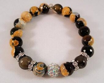 Gemstone bracelet in faceted sunset agate, Shamballaperle as well as Strassrondelle, elastic band