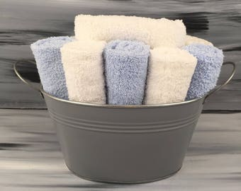 Gray Bathroom Towel/Wash Cloth Bin with metal handles - 1 white hand towel, 5 light blue and 5 white wash cloths.