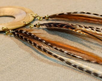 Single earring made of boxwood and Rooster feathers